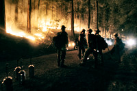 With torches at the ready the Ironwood Hotshots prepare to begin burning out along the 231 Road